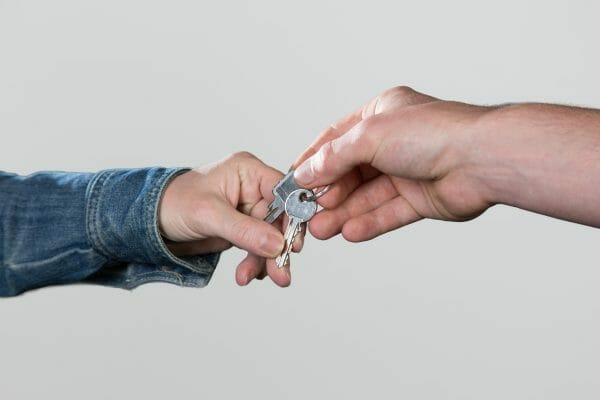 tenant handing landlord keys